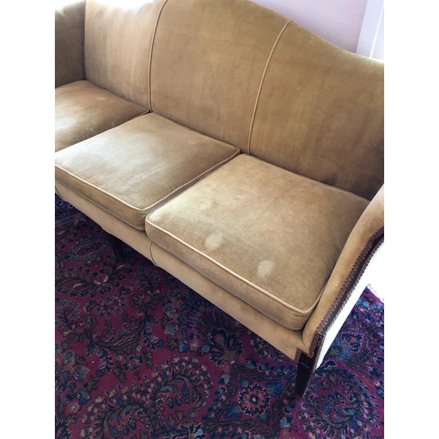 Stunning, classic and oh-so-handsome. This camel back, Chippendale style sofa boasts velvet upholstery in a...
