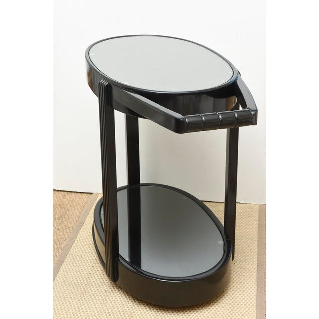 This stunning and very versatile Art Deco bar cart or trolley is very moderne. It is so sturdy and wheels beautifully. The...