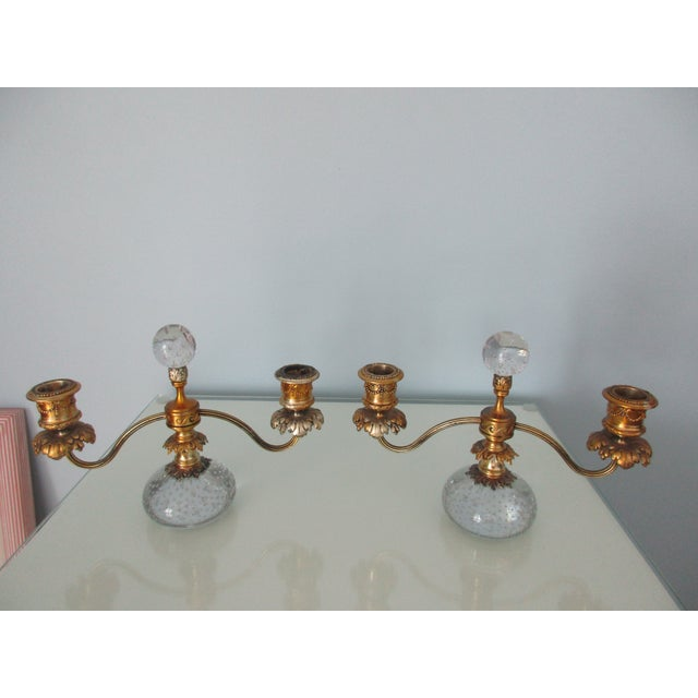 Here is a gorgeous pair of Pairpoint candelabras or candlesticks. The base of each piece is a large controlled bubble...
