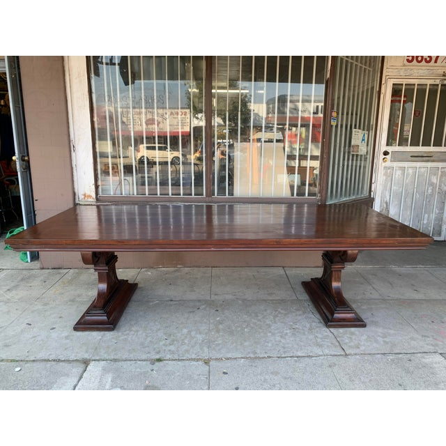 Beautiful large 2-piece dining table, very heavy top and 2 bases. The top is removable. Would look beautiful indoors.