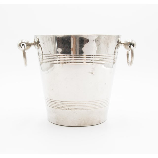 A fabulous Mid-Century French silver plated champagne bucket or wine cooler, made in Paris, France. Signed on reverse....