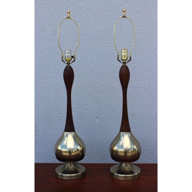 """1950s Tony Paul brass and walnut table lamps. Measures: Height to light socket 25"""" Shades for photography only."""