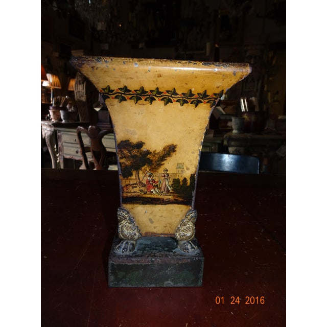 Single French Empire tole jardiniere painted by hand in ochre color with pastoral scenes. Paw feet. Zinc liner is missing