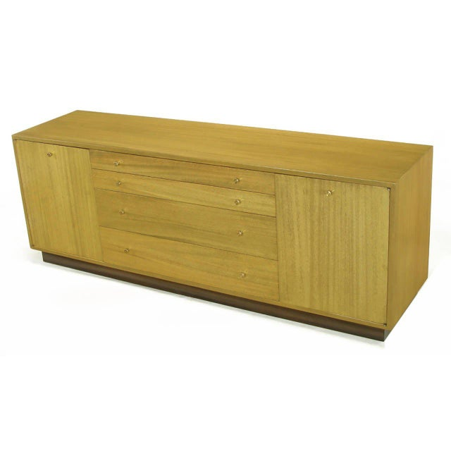 Harvey Probber long, low credenza or sideboard with four ascending height drawers and pair of shelved cabinets measuring...