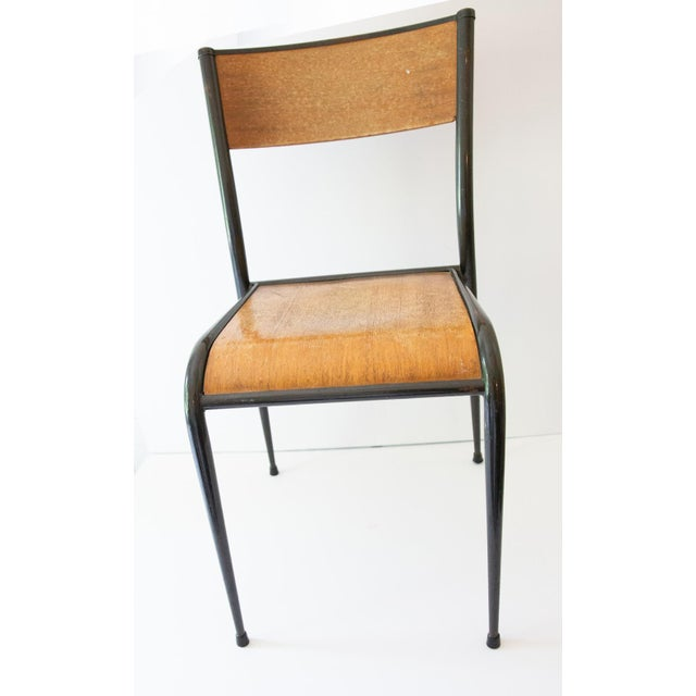 Two Jean Prouvé-style French school chairs from the 1930s.
