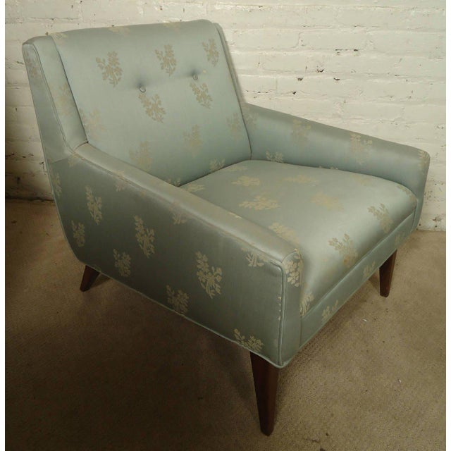Vintage-modern lounge chair, features floral upholstery with walnut base, includes matching ottoman. Ottoman Dimensions -...