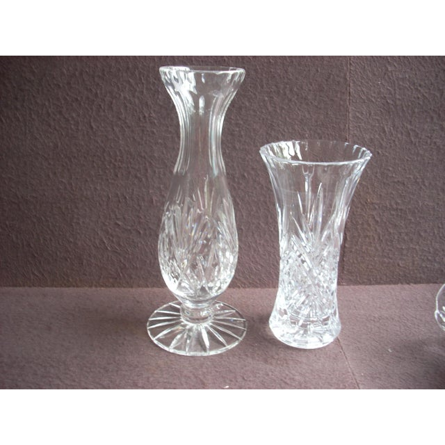 A pair of sparkling glass vases appropriate in any setting; both have starburst bases and a scalloped top edge; classic...