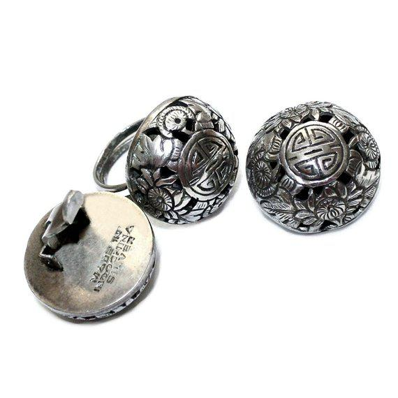 Very nice vintage sterling silver clip back earrings and ring embellished with Asian floral designs and characters. Signed...