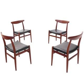 Hans Wegner Leather Upholstered Teak Dining Chairs - Set of 4 For Sale
