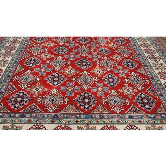 This beautiful Oriental rug is made with 100% wool and hand Knotted. This rug will add a stunning design accent to your...