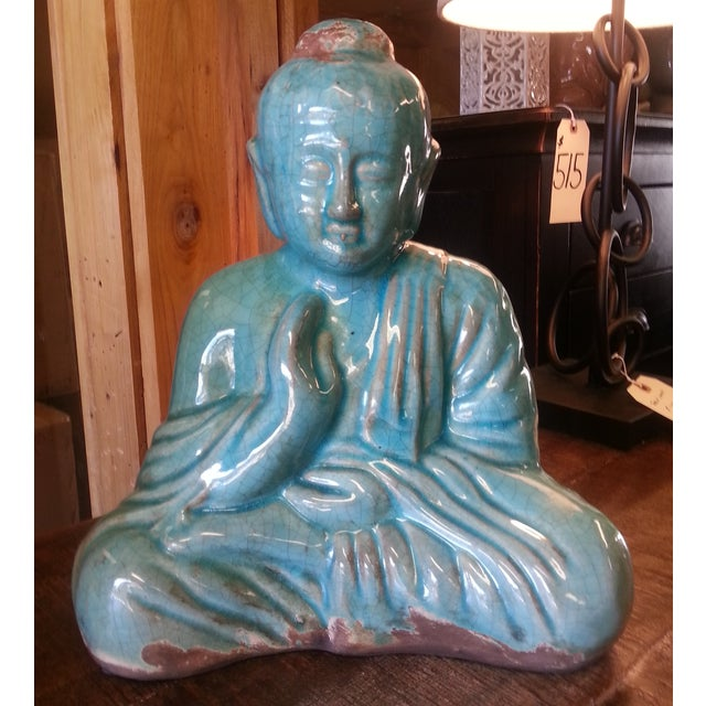 Ceramic sitting Buddha statue in a rustic turquoise blue 'crackle' finish. This amazing statue is made to look...