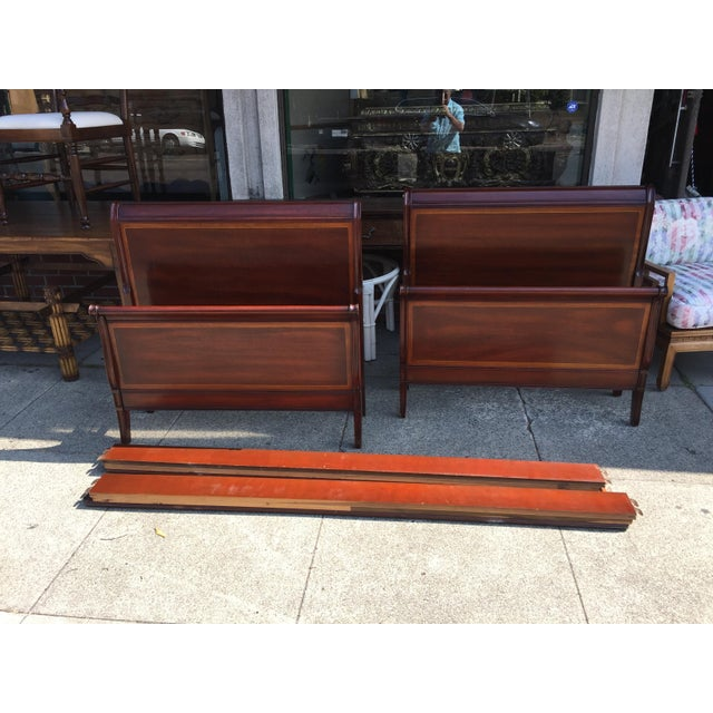 Pair of Drexel Sleigh beds with rails and slats. Mahogany, mid 20th century. In excellent condition, very sturdy and...