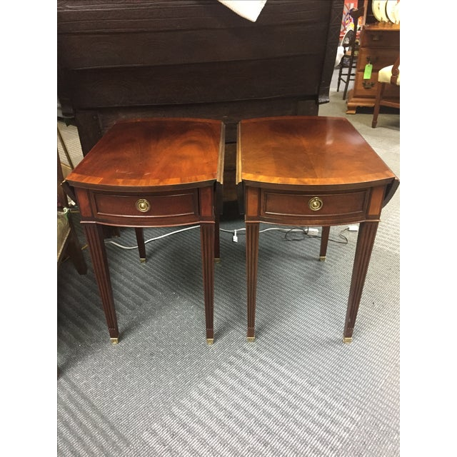 Pair of Baker drop leaf side tables with brass hardware in almost perfect condition. Single table dimensions with leaves...