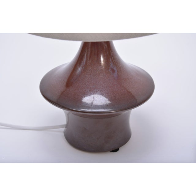 This lamp was produced in the 1970s in Denmark by Søholm Stentoj. It is made of stoneware and features a ceramic glaze in...