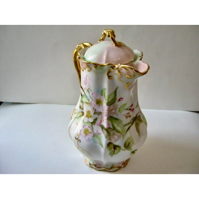 Gorgeous antique Limoges France hand painted apple blossom unique shape chocolate/cocoa pot. This pot is laden with...