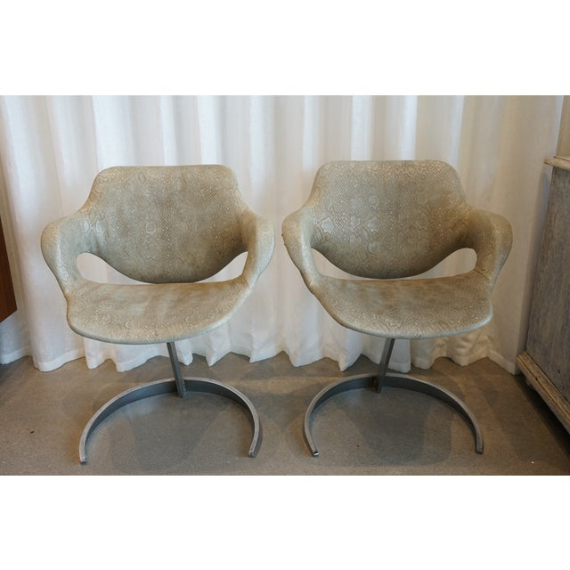 Circa 1970s, France. Vintage pair of Boris Tabocoff vintage green embossed leather chairs with curved chrome bases. Very...