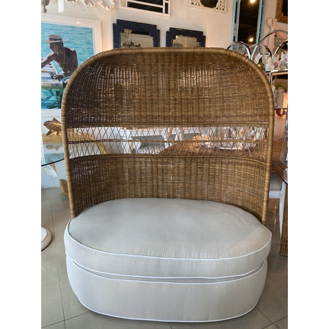 Lovely vintage wicker and rattan hooded settee loveseat chair. Newly upholstered in a Sunbrella cream fabric with white...