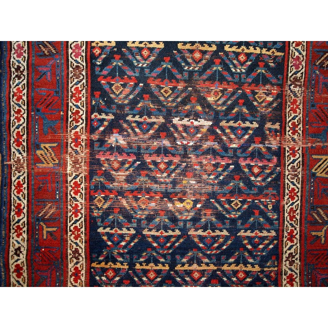 Antique hand made Persian Kurdish runner in dark blue shade. Traditional drops shaped design on the dark blue field in the...
