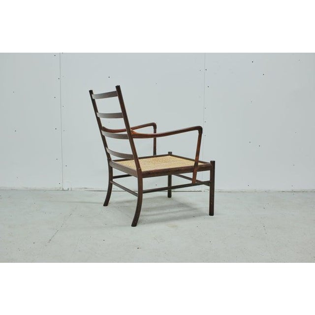 A rare rosewood Ole Wanscher Colonial chair, produced by P. Jeppesens Møbelfabrik in Denmark, 1960s. Good vintage...