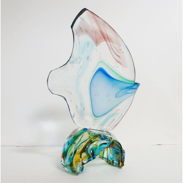 Italian fish on wave sculpture hand blown and crafted in multiple colors of Murano glass by Sergio Constantini, signed...