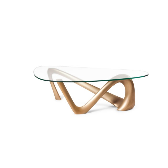 "Iris coffee table designed and manufactured by Amorph. The dimension of table base : 44""L x 20""W x 15""H glass dimensions:..."