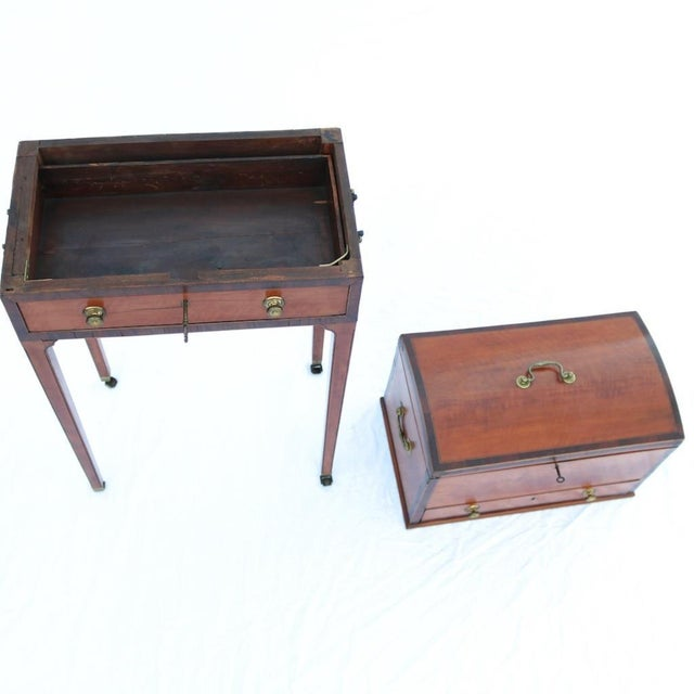 A rare and well proportioned humidor made of satinwood with mahogany banding. Attributed to Collinson & Lock, as the locks...