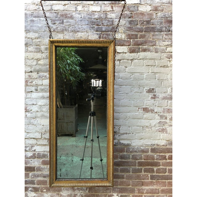 18th Century Louis XVI Pier Mirror Louis XVI, carved gilt wood mirror, Provenance France The rectangular and profiled...