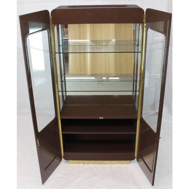 High quality Mid-Century Modern display cabinet. High gloss durable finish, rounded beveled glass panels, brass hardware...