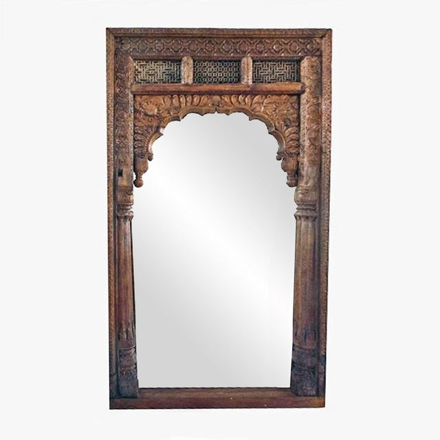 Antique architectural doorway from India. Intricate carved wood. Made into stunning full length mirror.