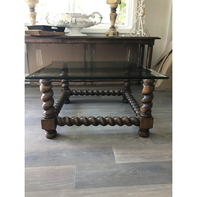 This coffee table is perfect for a small space. The wood base gives it a substantial look and the glass top makes it float...