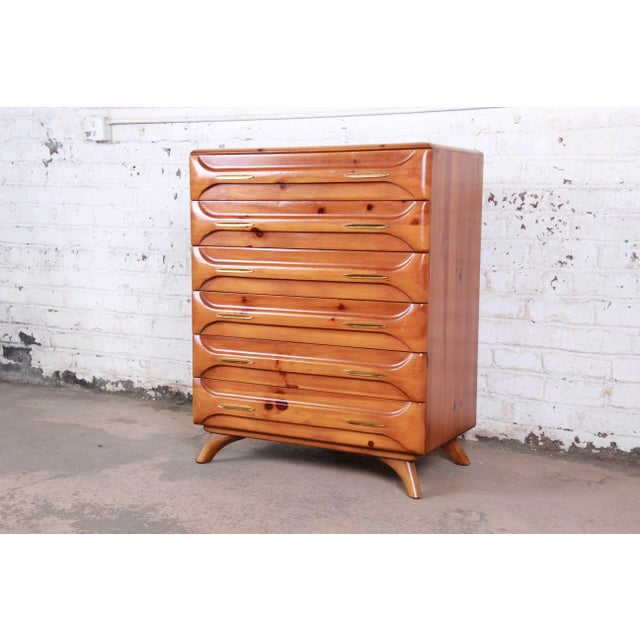 "An exceptional mid-century modern ""Sculptured Pine"" highboy dresser by Franklin Shockey Co. The dresser feature gorgeous..."