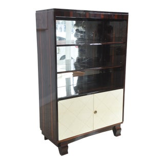 Art Deco Ebony De Macassar and Parchment Bookcase, Jean Pascaud For Sale