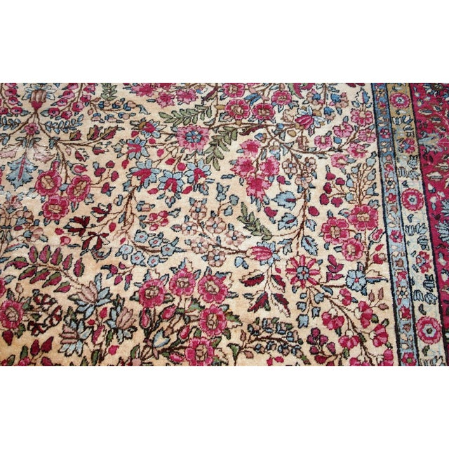 Antique handmade Persian Kerman lavar rug in beige shade. The rug is from the beginning of 20th century in original...