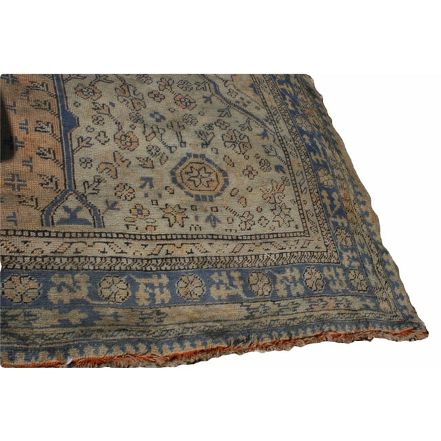 This Oushak features a Waterloo Design in its medallion, flowers on the entire faded apricot field and amazing ivory...