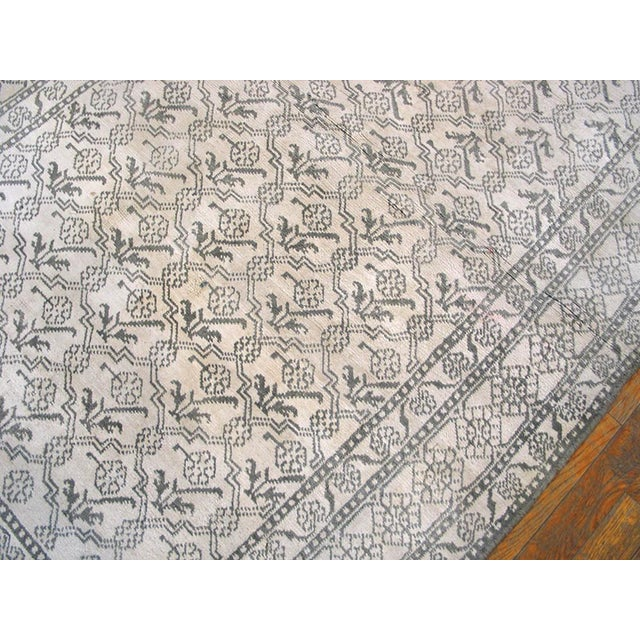 """This is a vintage wool agra rug from 1920 India. The size is 4'x6'7"""". It is gray and white. There are patterns all over it..."""