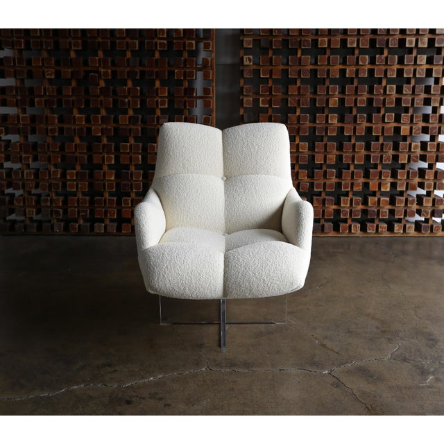 Vladimir Kagan Lucite and bouclé swivel lounge chair, circa 1970. This piece has been expertly restored in Holly Hunt...