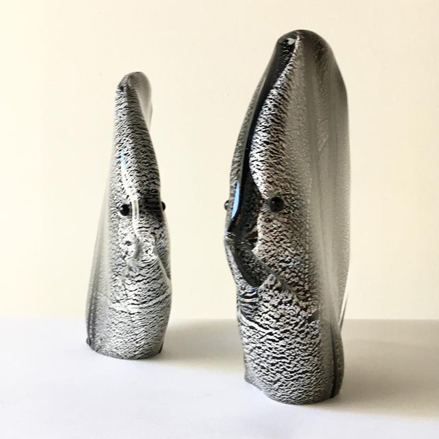 A Pair of Murano Black and Silver Aventurine Glass Fish Sculptures attributed to Seguso Cased in Clear and Purple Glass 1960s