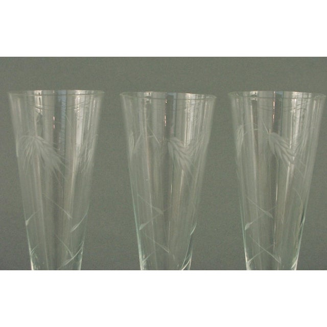 Beautifully wheel-cut designs of wheat adorn these glasses, which are in perfect condition. Measurements: 8 ½ high by 2 ¾...