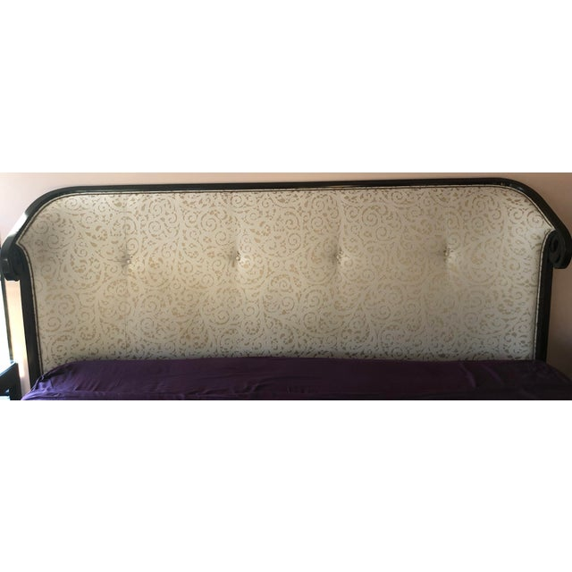 This sleek wing-backed headboard from Christopher Guy features a simple upholstered buttoned headboard and sweeping hard-...