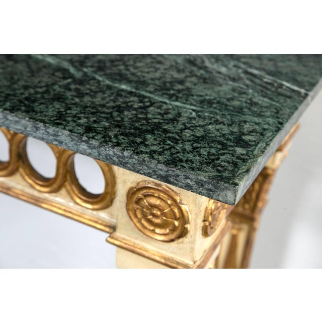 Louis XVI style marble-top console. A fine Italian paint decorated marble-top console in the style of Jansen. The gilt...