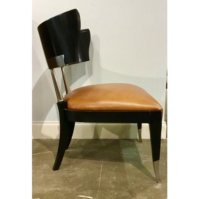Stylish modern leather Klismos Chair by: Caracole, ebony finished wood frame with nickel ferrules and cognac leather seat,...