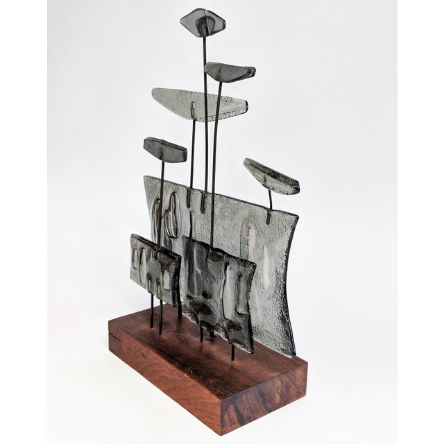 Truly stunning art glass sculpture created with 8 separate glass pieces in grey and white tones. They are mounted to...
