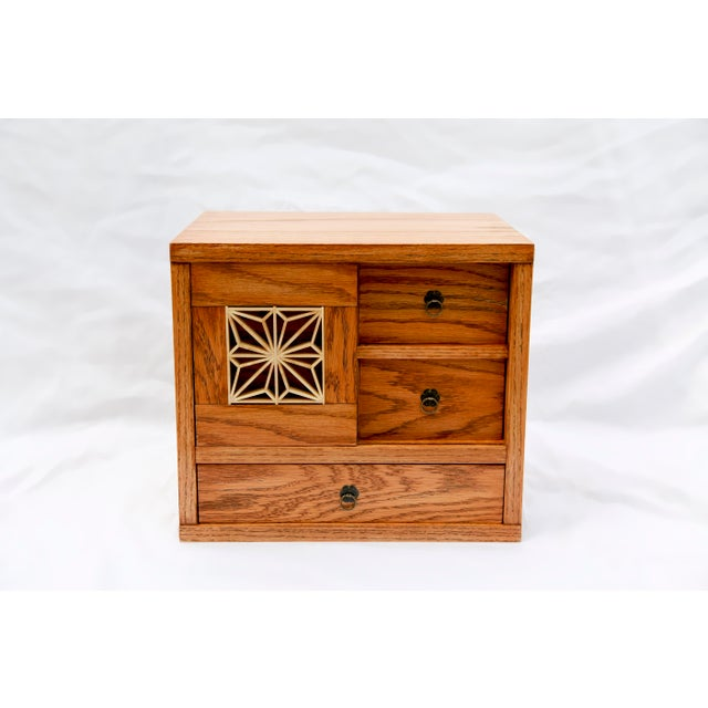 Kumiko treasure chest, inspired by traditional Japanese pieces that include an intricate hand carved lattice-like detail...