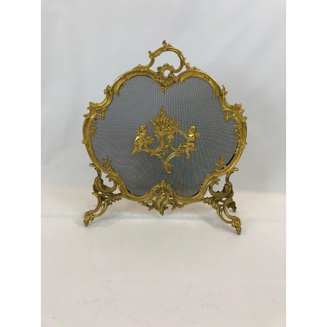 A superbly pretty sculptural fireplace screen having a scalloped rounded bronze dore frame in fancy French style, central...