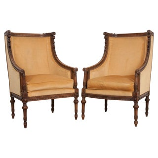 Pair of French 19th Century Louis XVI Carved Walnut Bergères For Sale