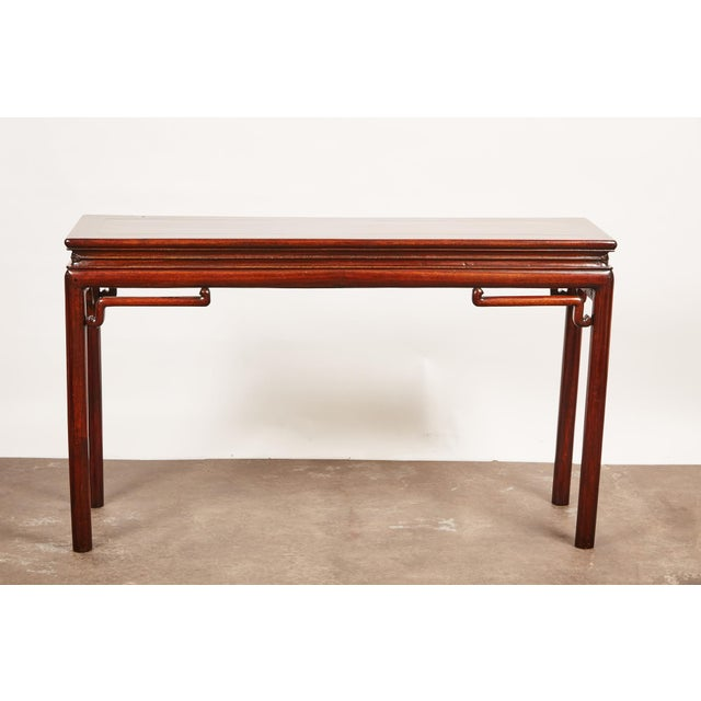 Rosewood altar table with delicate elbow braces.