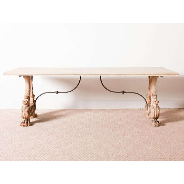 Heavy wood dining table with hand-carved legs Iron stretchers Italy Circa 1860