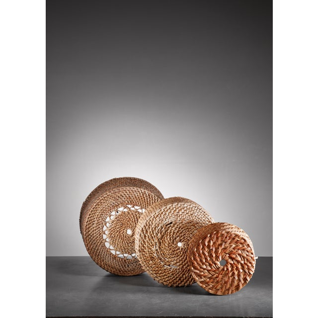 A set of three round folk art baskets made of woven twigs and birch bark. The measurements stated are of the largest...