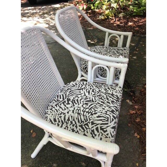 Set of 2 vintage white rattan armchairs, recently recovered painted and recovered in Perennials indoor/outdoor fabric....