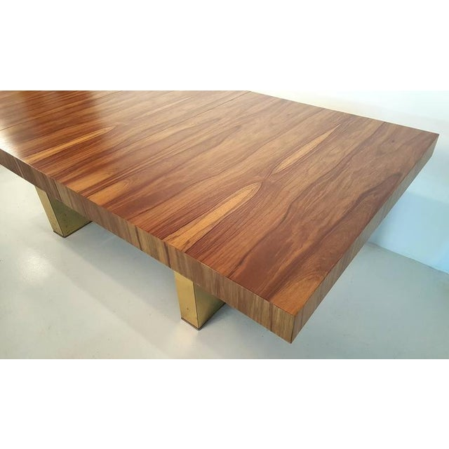 1970s Milo Baughman dining table in exotic bleached Brazilian rosewood with brass pedestals manufactured by Thayer Coggin....